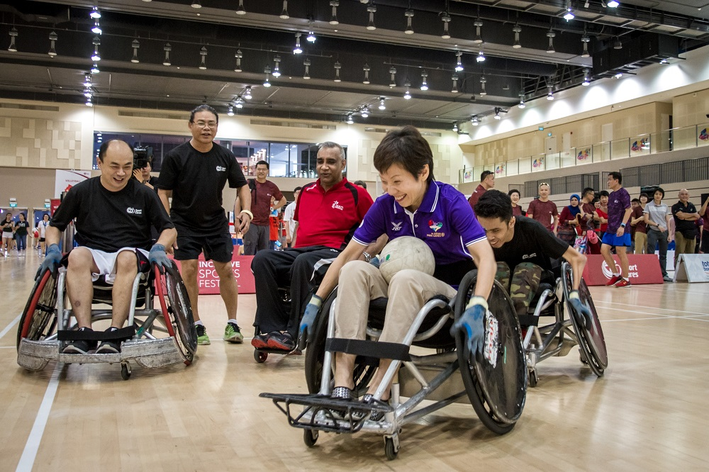 Guest of Honour, Minister Grace Fu playing wheelchair rugby with participants at Our Tampines Hub during the launch of Inclusive Sports Festival. Photo by Charles Loh/SportSG