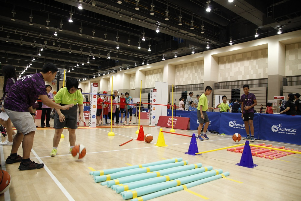 Members of the public giving the sports try out zones a shot during the launch of Inclusive Sports Festival at Our Tampines Hub. Photo by SportSG