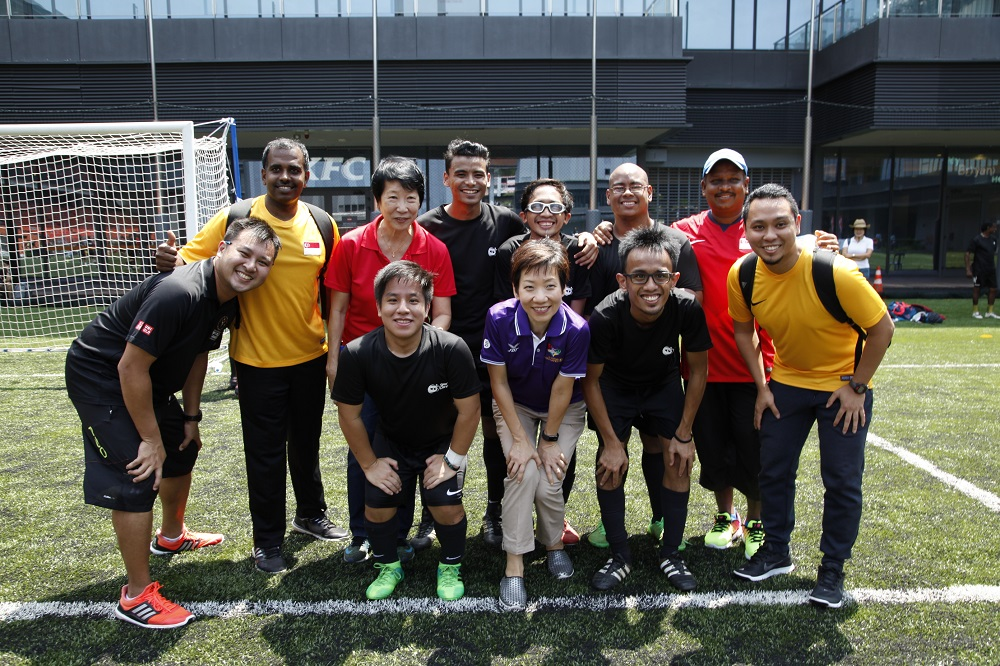 GOH Minister Grace Fu taking a group photo with football players during the launch of Inclusive Sports Festival at Our Tampines Hub. Photo by SportSG