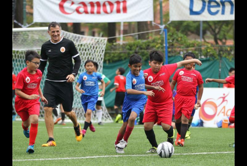 ActiveSG Football Academy Principal Aleksandar Duric with participants during the launch of the Active Cubs Programme at Jurong East Stadium on 12 March 2017. Photo: Sport Singapore