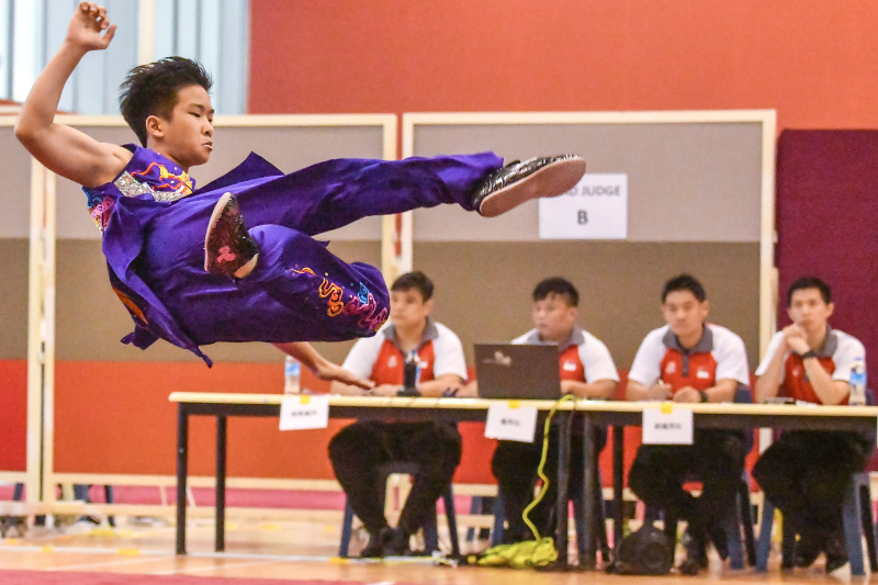 A wushu participant displays his flying kick in the air during the National School Games Wushu Championships. Photo by Andrew JK Tan/SportSG
