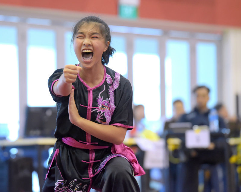 A young female nanquan participant letting out a boisterous shout during the competition. Photo by Leong Ah Chai/SportSG