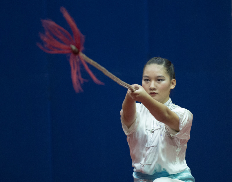 A female gunshu competitor lunging her weapon forward in her competition routine. Photo by Cheah Cheng Poh/SportSG