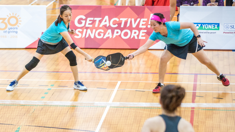 Chong Lee Ping & Chen Xiao Hong in action during the Singapore National Games 2018 Pickleball Tournament, Individual Intermediate Open Women's Doubles Round Robin at Jurong West Sports Centre  on July 29th. Photo by Dyan Tjhia/SportSG