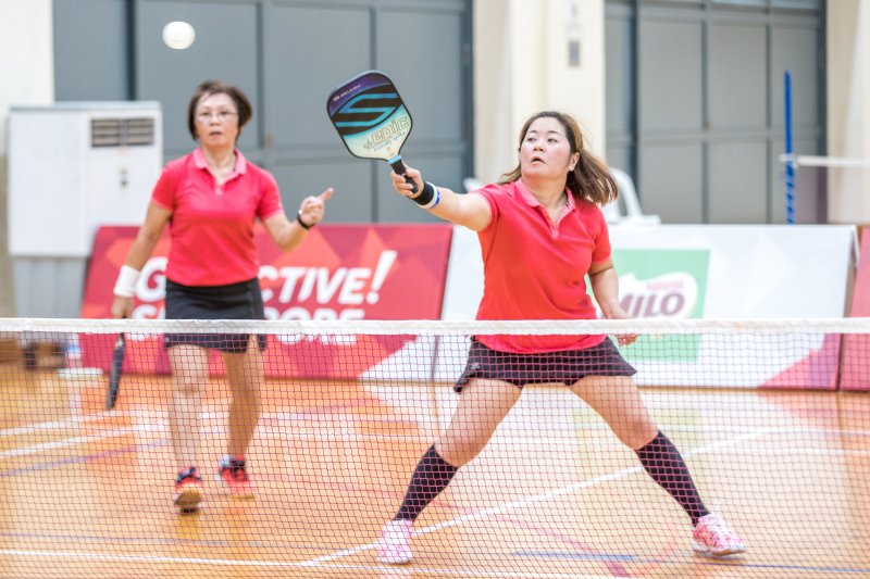 Wai Kun Fong & Cynthia Ler Lee Ai in action during the Singapore National Games 2018 Pickleball Tournament, Individual Intermediate Open Women's Doubles Round Robin at Jurong West Sports Centre  on July 29. Photo by Dyan Tjhia/SportSG