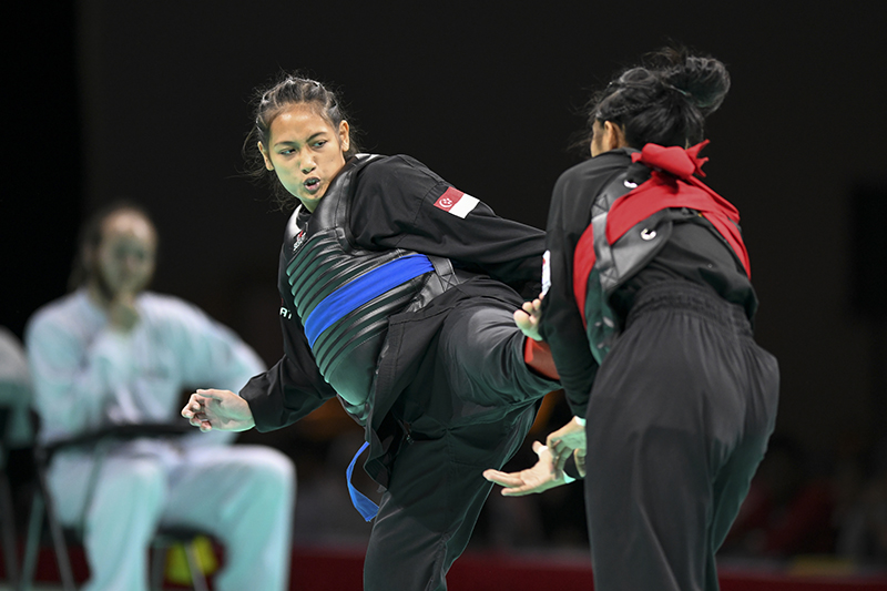 World Pencak Silat Championship 2018 (WPSC 2018) - Match #233 - highlights of the match between Siti Khadijah representing Singapore (blue corner) and Paphawinee Kueakoboon representing Thailand (red corner). Singapore beat Thailand 5-0 Photo by Ben Cho/SportSG