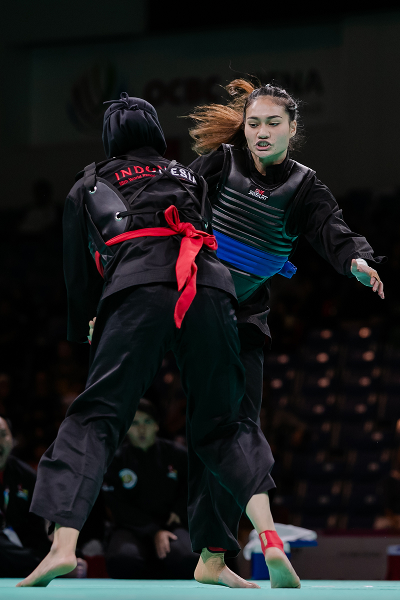 Singapore's Nurul Suhaila (blue belt) in action during the Senior Female semi final against Indonesian Selly Andriani during the World Pencak Silat Championship 2018 on 15 December. Photo by Abdul Rahman/SportSG