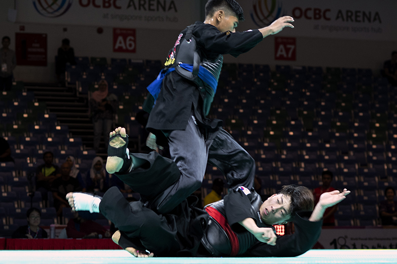 2018 World Pencak Silat Championship - Tanding - Male Category D, above 60-65kg - Quarter Finals -  Singapore Sports Hub, OCBC Arena, Singapore - December 15, 2018 - Abdul Raazaq Bin Abdul Rashid (SGP) v. Kang Min (KOR) Photo by Alfie Lee/SportSG