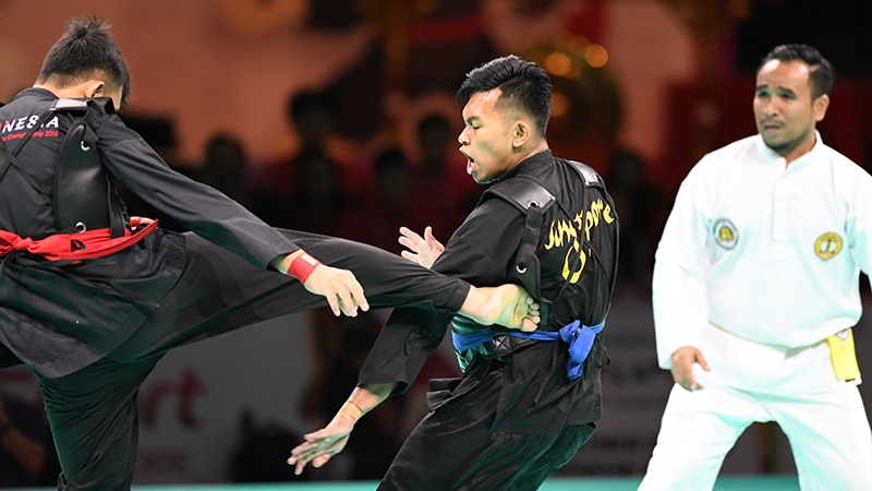 World Pencak Silat Championship 2018 (WPSC 2018). Match #238 highlights. QF Match between Abdul Raaziq representing Singapore (blue corner) and I Kadek Wahyu R. representing Indonesia (red corner). Match was won by Singapore 5-0. Photo by Ben Cho/SportSG