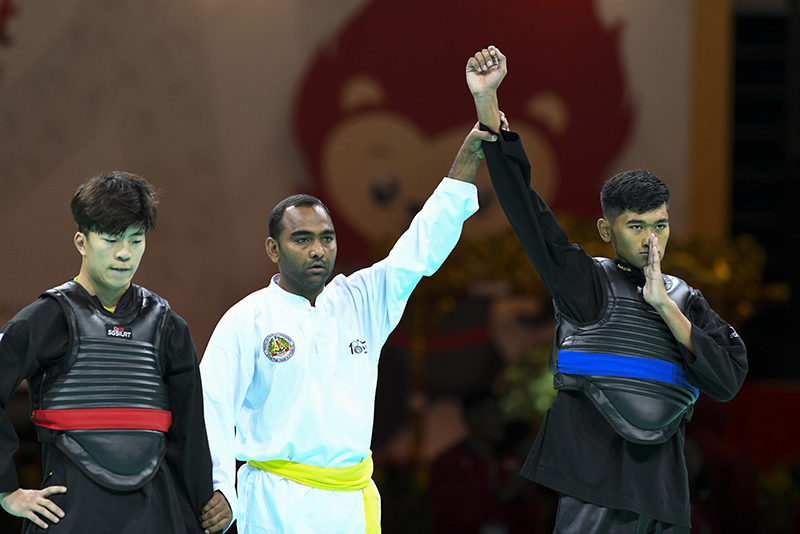 20181215 World Pencak Silat Championship 2018 (WPSC 2018). Match #240 highlights. QF Match between Abdul Raazaq representing Singapore (blue corner) and Kang Min representing Korea (red corner). Match was won by Singapore 3-2. Photo by Ben Cho/SG
