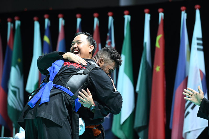 2018 World Pencak Silat Championship - Tanding - Male Category I, above 85-90kg - Semi Finals -  Singapore Sports Hub, OCBC Arena, Singapore - December 15, 2018 - Sheik Ferdous Bin Sheik Alau'ddin (SGP) celebrates his victory against v. Firdhan Wahyu (INA) Photo by Suki/SportSG