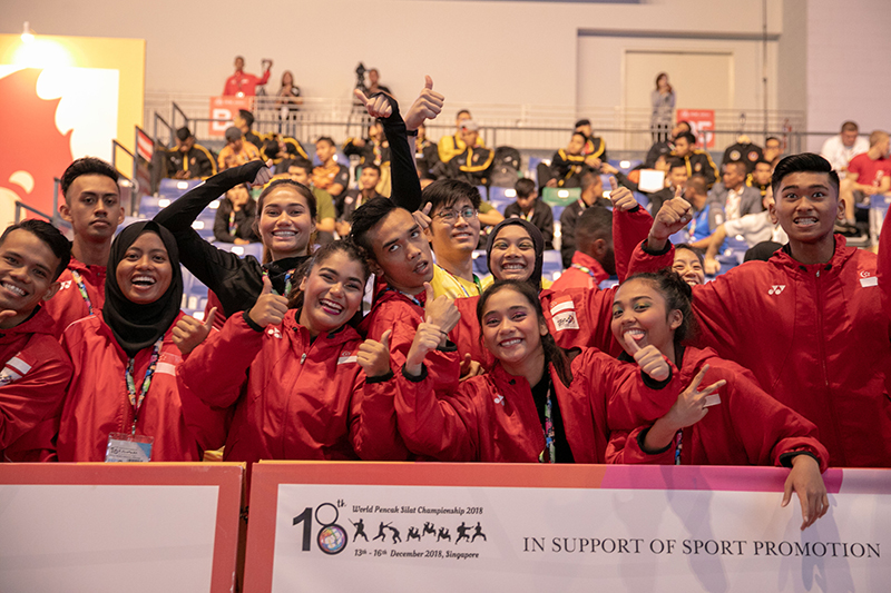 2018 World Pencak Silat Championship - Seni - Male Doubles - Finals - Singapore Sports Hub, OCBC Arena, Singapore - December 13, 2018 - Team Singapore showing their support for Nur Hakim Bin Norshamsuddin and Syafiq Syazry Bin Mohd Abdul Majid (SGP). Photo by Daryl Yeo/SportSG