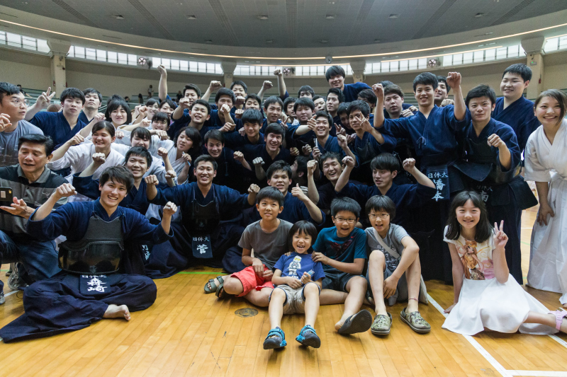 Japanese martial artists all crowd together for a photo post performance. Photo by Ken Chia/SportSG