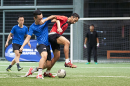 Light feet and heavy striking in the Men's category at the FAS Midnight Football Challenge. Photo by Mohamed Ali/SportSG