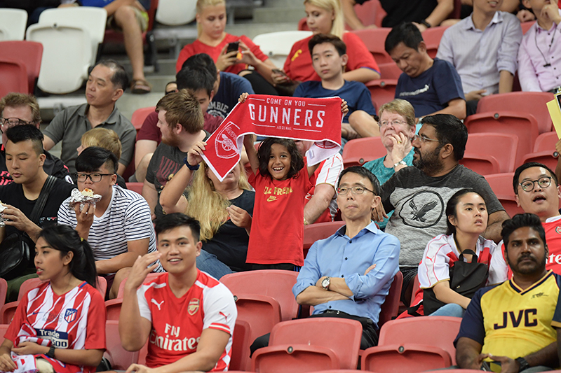 A young Arsenal fan stands out at the International Champions Cup 2018 held at the Singapore Indoor Stadium on 26 July. Photo by Lim Sau Boon/SortSG