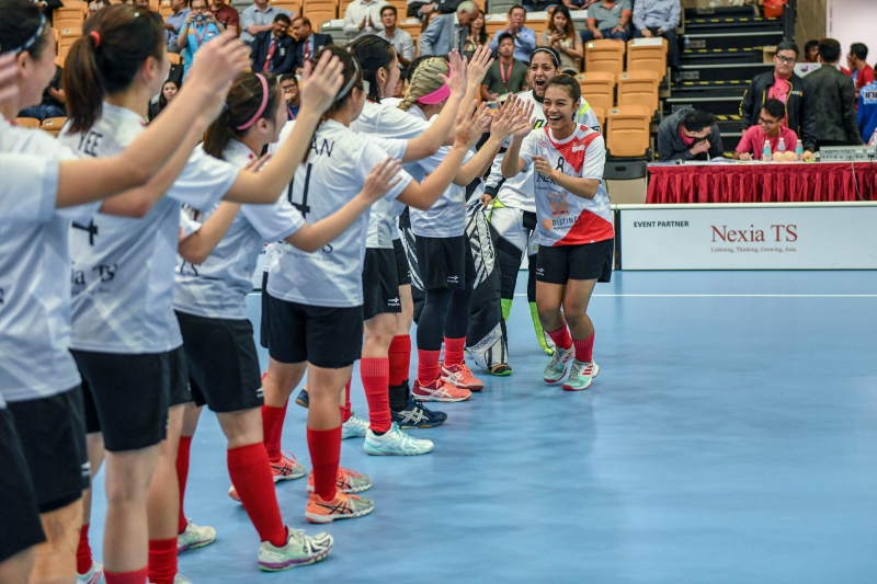 Singapore floorball players cheer on their team mate during the team introductions before the game. Photo by Suki Singh/SportSG