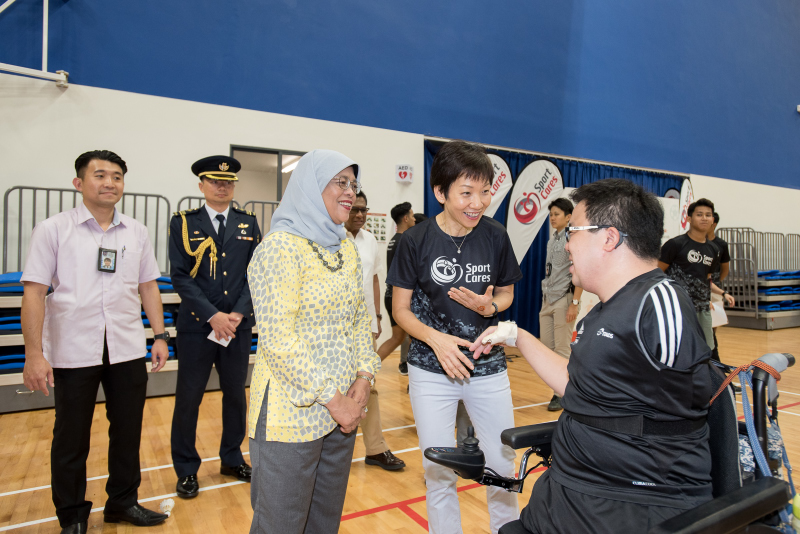 Jason Chee speaks with President Halimah Yacob and Minister Grace Fu during the play-ability event held by Temasek Foundation Cares. Photo by Flona Hakim/SportSG
