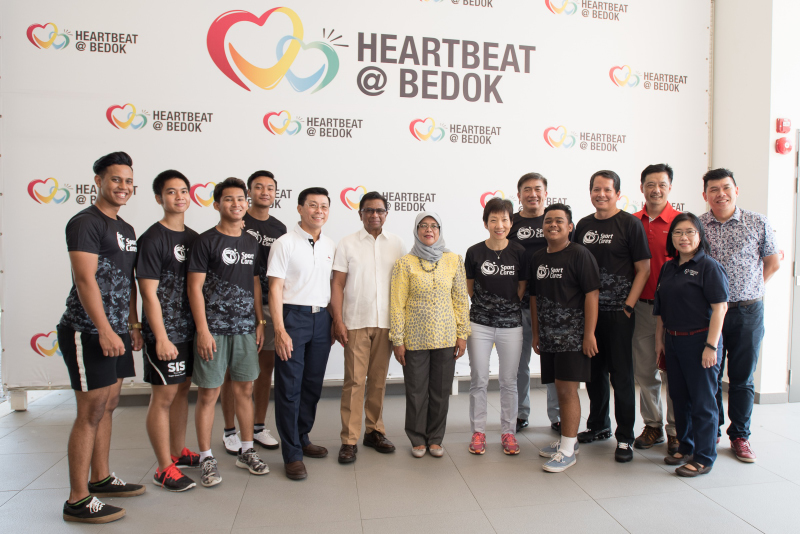 President Halimah Yacob, Minister Grace Fu and Chairman of Temasek Foundation Cares, Richard Magnus pose in a group photo together. Photo by Flona Hakim/SportSG