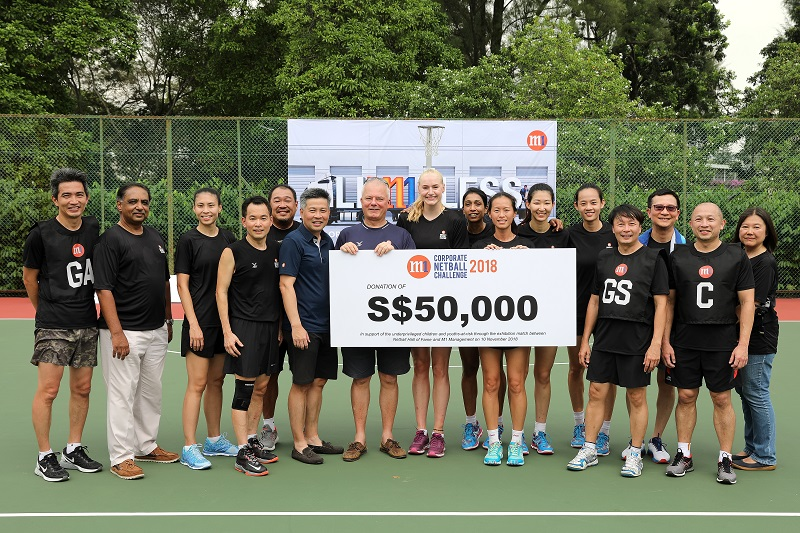 all of Fame members, receiving cheque from Patrick Scodeller, Chief Operating Officer, M1 and the M1 senior management at the M1 Corporate Netball Challenge on 10th November 2018. Photo: netball singapore