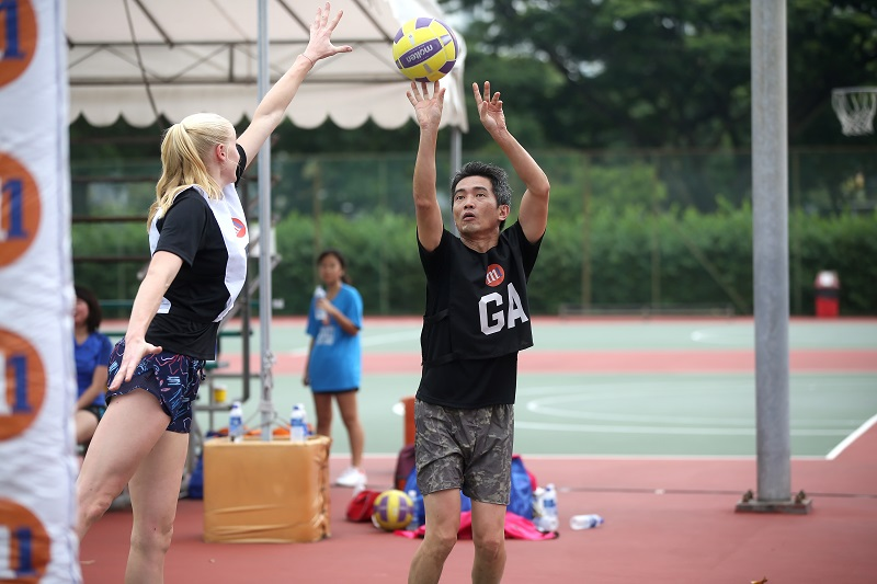 Ivan Lim Director of Corporate Communications  Investor Relations M1 aiming for a shot with Jo Weston Australian Diamonds in defence Photo: netball singapore
