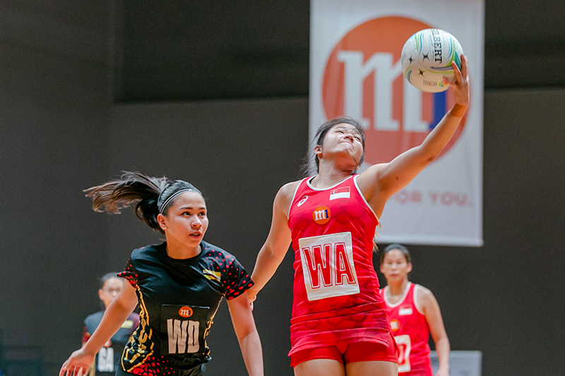 Some of the action during the first day of the M1 Asian Netball Championship 2018 with Singapore against Brunei. Singapore won 68-19. Photo by Abdul Rahman Bujang/SportSG
