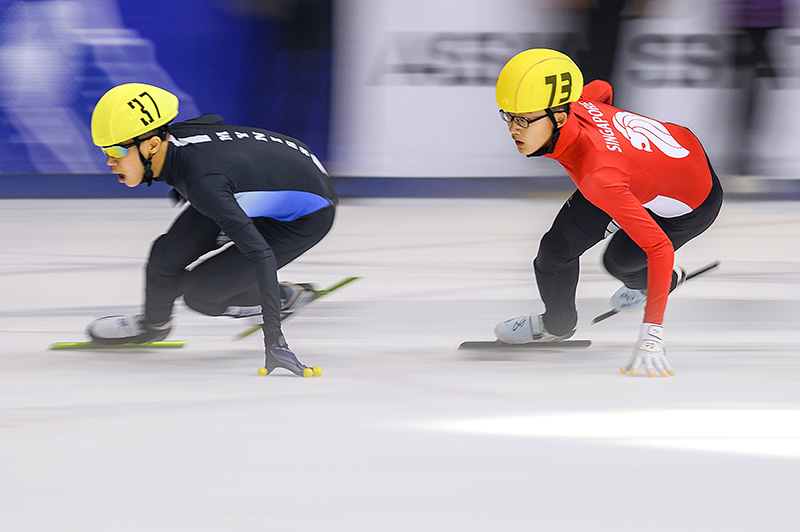 Team Singapore's Xu Jingfeng #73 hot on the heels of Malaysia's #37 Lau Newjoe. Taken at SEA Open short Track Trophy 2019 held on 5th Jan 2019 at The Rink @JCube Singaporean skater #73 in action Photo by Andrew J K Tan/SportSG