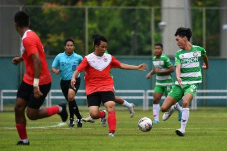 A football match between Singapore Premier League teams Geylang International (in green) and Tanjong Pagar United (in red) at Jurong West Stadium on Feb 8, 2020.ST PHOTO: LIM YAOHUI